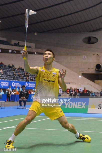 Chong Wei Lee of Malaysia competes in the Men's singles final match against Boonsak Ponsana of Thailand during day five of the Yonex Open Japan 2012...