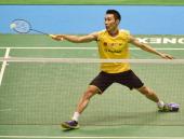 Chong Wei Lee of Malaysia dives to receive a shot against Yun Hu of Hong Kong China during day six of Badminton YONEX Open on June 15 2014 in Tokyo...