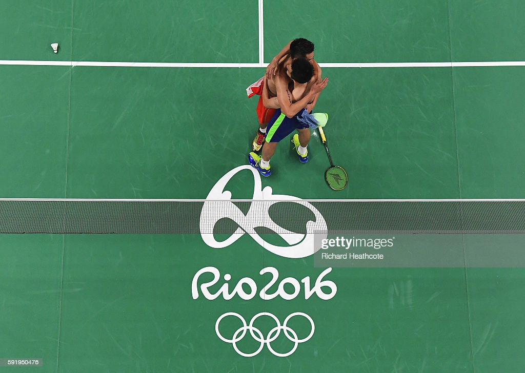 Chong Wei Lee of Malaysia embraces Dan Lin of China after winning the Men's Singles Badminton Semifinal on Day 14 of the Rio 2016 Olympic Games at...