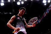 Chong Wei Lee of Malaysia looks at his racquet in the Men's Singles Badminton SemiFinal against Long Chen of China on Day 7 of the London 2012...