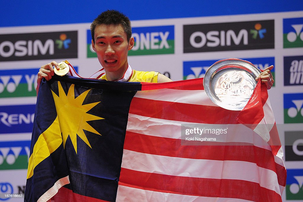 Chong Wei Lee of Malaysia poses on the podium after winning the Men's singles final match against Boonsak Ponsana of Thailand during day five of the Yonex Open Japan 2012 at Yoyogi Gymnasium on September 23, 2012 in Tokyo, Japan.