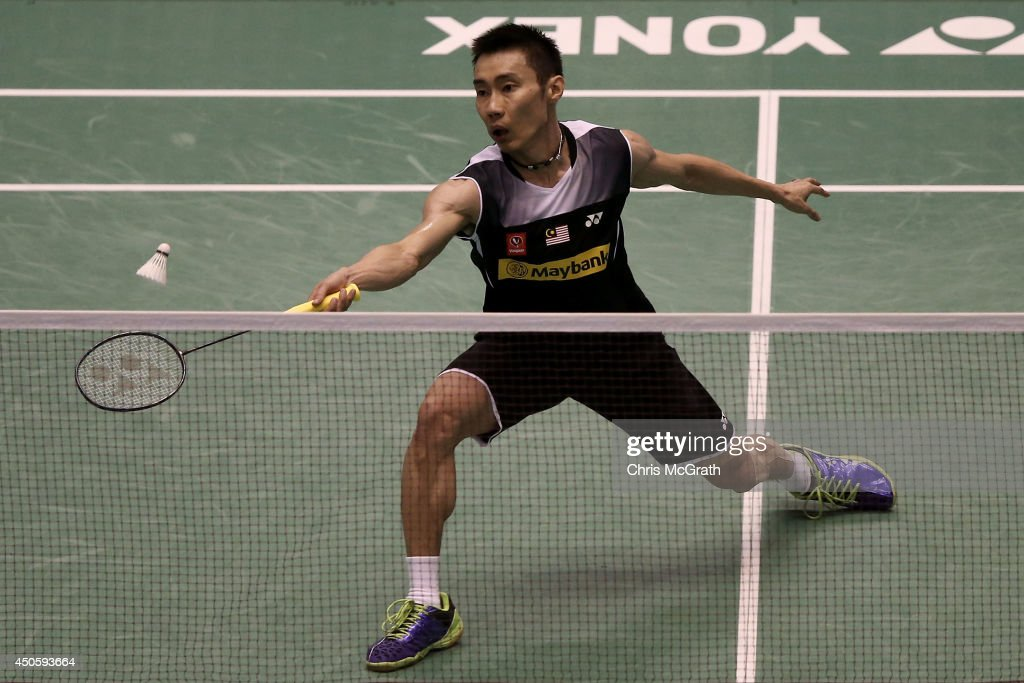 Chong Wei Lee of Malaysia returns a shot against Kenichi Tago of Japan during their Men's Single semi final match on day five of the Badminton YONEX Open on June 14, 2014 in Tokyo, Japan.