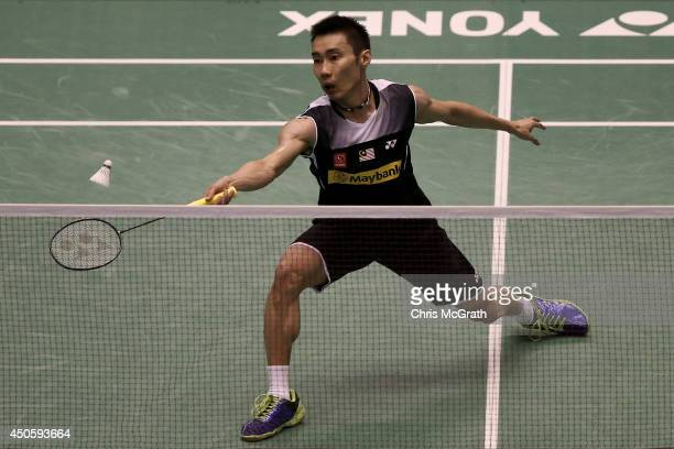 Chong Wei Lee of Malaysia returns a shot against Kenichi Tago of Japan during their Men's Single semi final match on day five of the Badminton YONEX...
