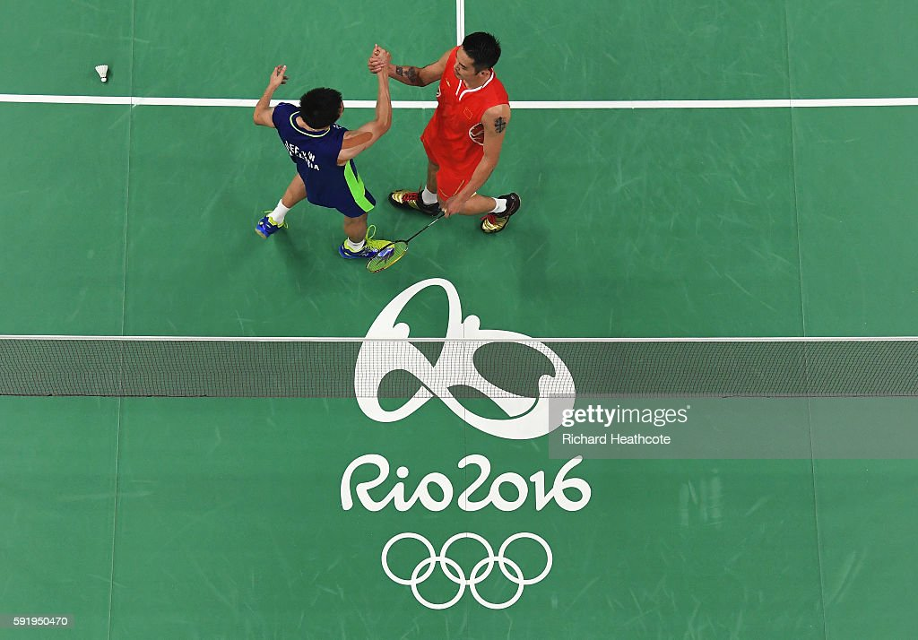 Chong Wei Lee of Malaysia shakes hands with Dan Lin of China after winning the Men's Singles Badminton Semifinal on Day 14 of the Rio 2016 Olympic...