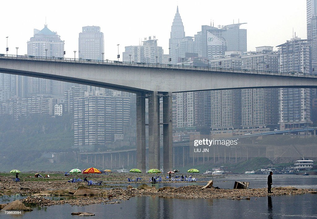 TO GO WITH 'CHINADROUGHTWARMINGFARM' Local residents enjoy a day out on the dry riverbed of the Jialing river a tributary of the Yangtze river with...