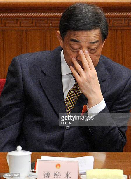 Chongqing mayor Bo Xilai attends the opening session of the National People's Congress at the Great Hall of the People in Beijing on March 5 2012...