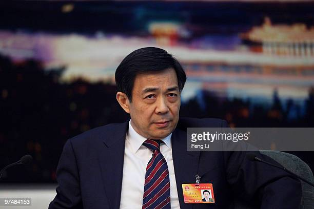 Chongqing Municipality Communist Party Secretary Bo Xilai attends a meeting during the annual National People's Congress at the Great Hall of the...