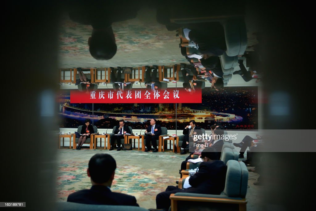 Chongqing Municipality Communist Party Secretary Sun Zhengcai (2nd L) and Chongqing Mayor Huang Qifan (3rd L) attend the Chongqing delegation's group meeting during the annual National People's Congress at the Great Hall of the People on March 6, 2013 in Beijing, China. Sun answers media's question Wednesday that he knows nothing about the trial of Bo Xilai. The 12th National People's Congress goes on till March 17th.