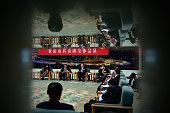 Chongqing Municipality Communist Party Secretary Sun Zhengcai and Chongqing Mayor Huang Qifan attend the Chongqing delegation's group meeting during...