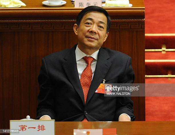Chongqing Party Secretary Bo Xilai attends the closing ceremony of the National People's Congress at the Great Hall of the People in Beijing on March...