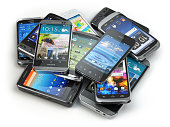 Choose mobile phone. Heap of the different smartphones. 3d