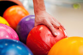 Close-up of a hand holding bowling ball