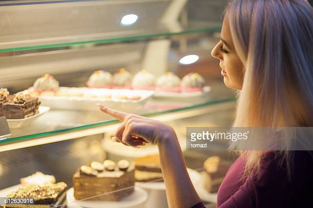Choosing sweets in a coffee shop