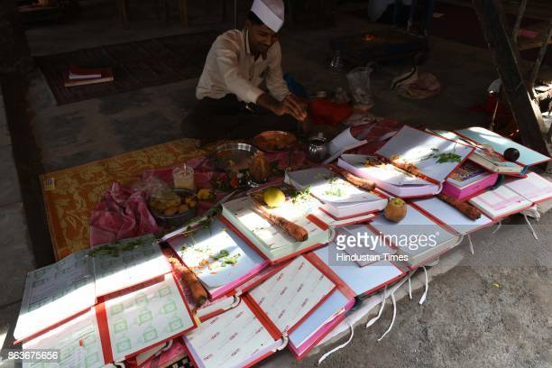 Chopda Pujan is being performed at APMC Market on October 19 2017 in Mumbai India On this day they do puja of account books and start writing their...
