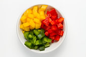 3 color Chopped Bell pepper in white ceramic bowl.