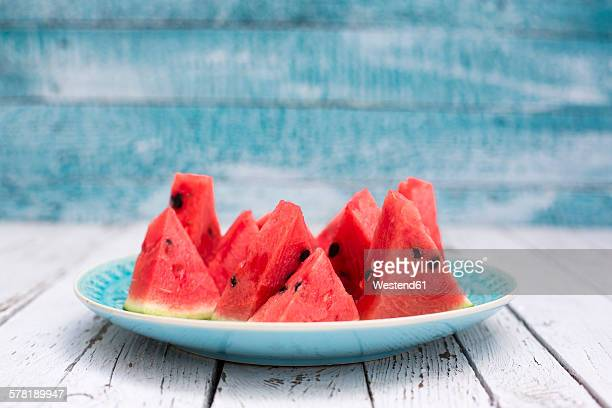 Chopped watermelon on blue plate