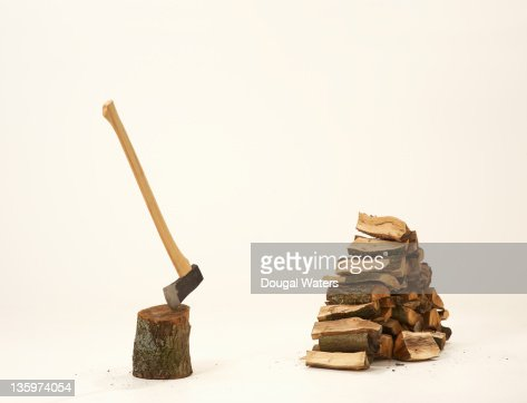 Chopped wood with axe in stump. : Stock Photo