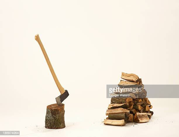 Chopped wood with axe in stump.