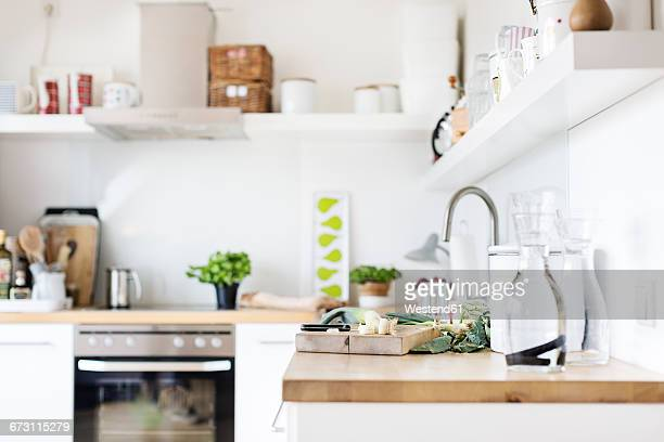 Chopping board with leek on kitchen counter