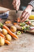 Woman Chopping food ingredients