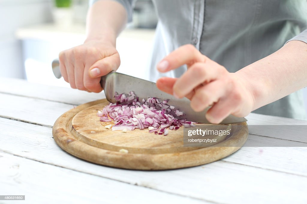 Chopping onions for salads : Stock Photo