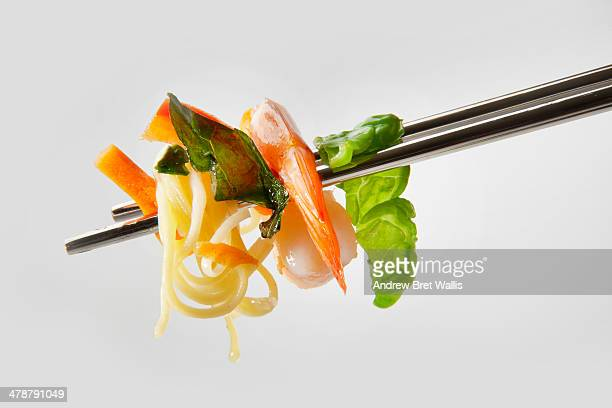 Chopstick serving of prawns and noodles