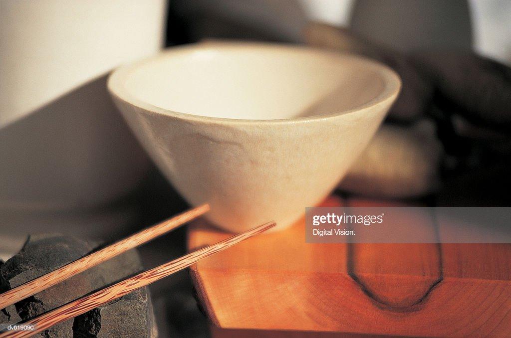 Chopsticks and Ceramic Bowl : Stock Photo