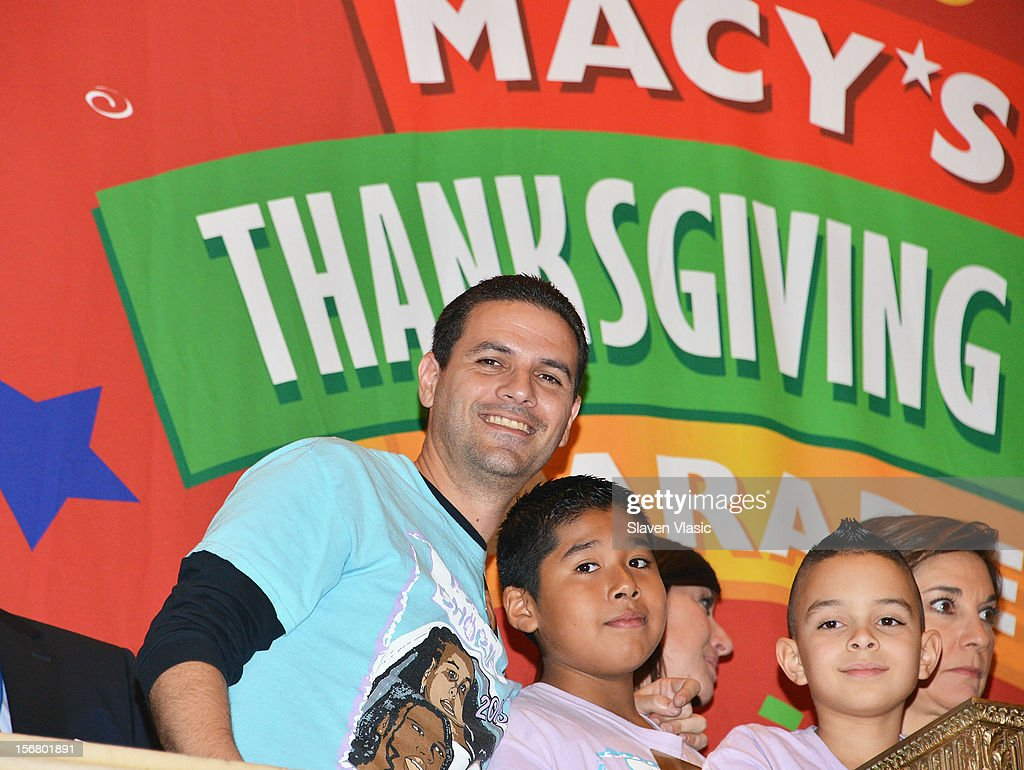 PS 22 choral director Gregg Breinberg (L) rings The Opening Bell at the New York Stock Exchange to celebrate the 86th Annual Macy's Thanksgiving at New York Stock Exchange on November 21, 2012 in New York City.