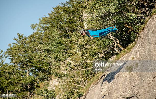 Wingsuiter with a black and blue wingsuit jumping into the Bourne Gorges Vercors Regional Natural Park between PontenRoyans and VillarddeLans