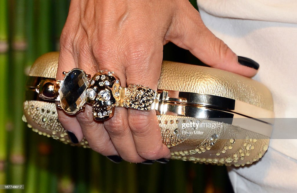 Choreographer and Pussycat Dolls creator Robin Antin (rings and purse details) attends the grand opening celebration of the world's first Nobu Hotel Restaurant and Lounge Caesars Palace on April 28, 2013 in Las Vegas, Nevada.