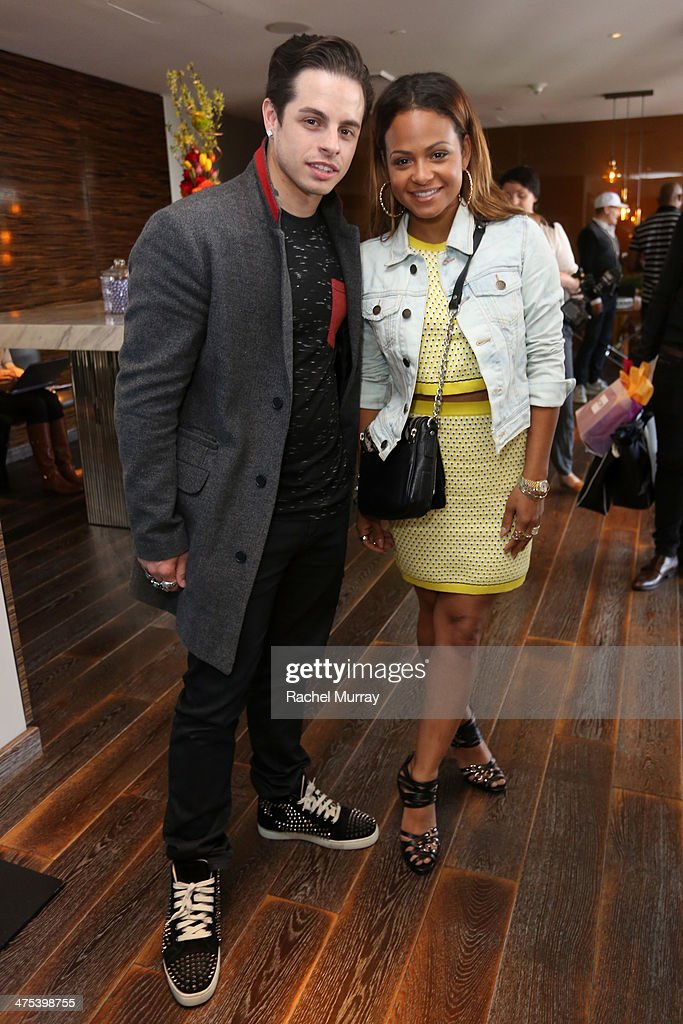 Choreographer Casper Smart (L) and actress Christina Milian attend Kari Feinstein's Pre-Academy Awards Style Lounge at the Andaz West Hollywood on February 27, 2014 in Los Angeles, California.