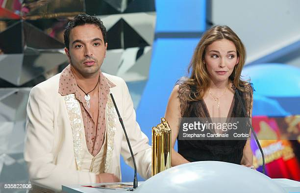 Choreographer Kamel Ouali and singer Claire Keim present an award at the 2004 NRJ Music Awards