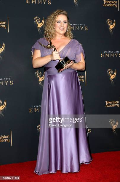 Choreographer Mandy Moore poses in the press room with the award for outstanding choreography for 'Dancing With The Stars' during the 2017 Creative...