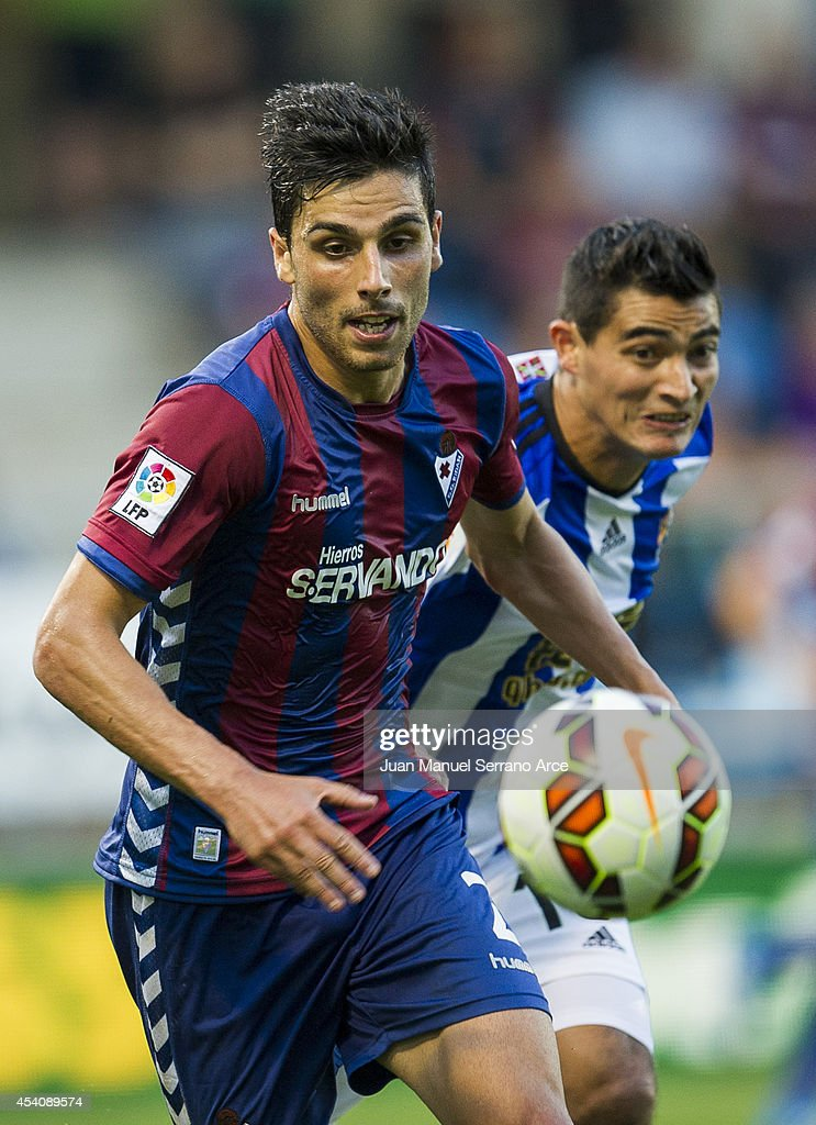Chori Castro of Real Sociedad duels for the ball with Eneko Boveda of SD Eibar during the La Liga match between SD Eibar and Real Sociedad at Ipurua Municipal Stadium on August 24, 2014 in Eibar, Spain.