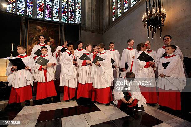 A chorister in the choir of King's College Cambridge ties his shoe during a rehearsal of their Christmas Eve service of 'A Festival of Nine Lessons...