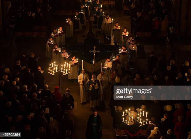 Choristers carry candles during the annual 'darkness to light' advent procession at Salisbury Cathedral on November 28 2014 in Salisbury England The...