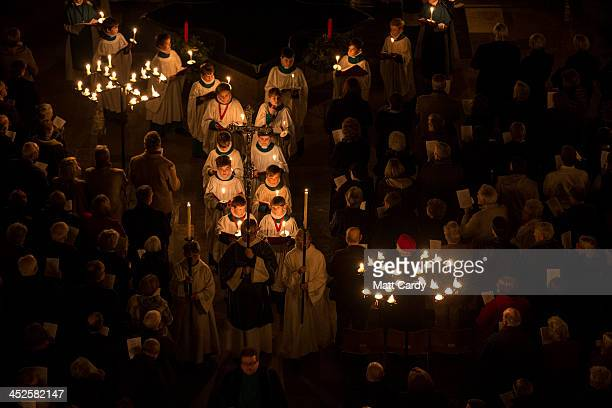 Choristers carry candles through Salisbury Cathedral illuminated by candle light during the annual 'darkness to light' advent procession on November...