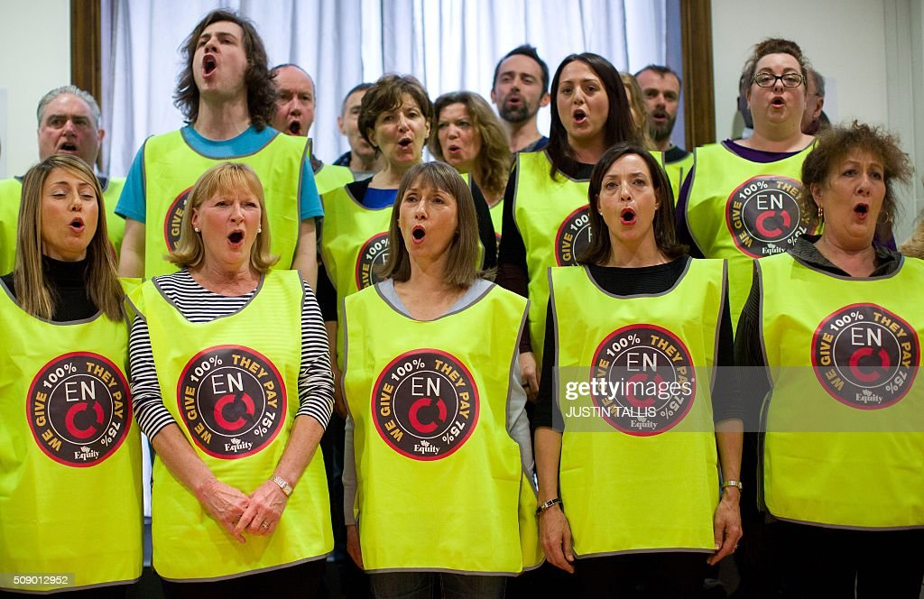 Choristers from the English National Opera (ENO) perform 'Hail Poetry' from 'The Pirates of Penzance' during a press conference in London on February 8, 2016. Singers at one of London's top opera houses, the English National Opera (ENO), could go on strike in a dispute over jobs and pay after a ballot on industrial action, their union said Monday. / AFP / JUSTIN TALLIS