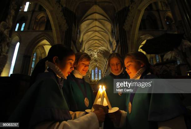 Choristers from the Salisbury Cathedral Choir light candles as they prepare to practice ahead of the services that will be held tomorrow in the...