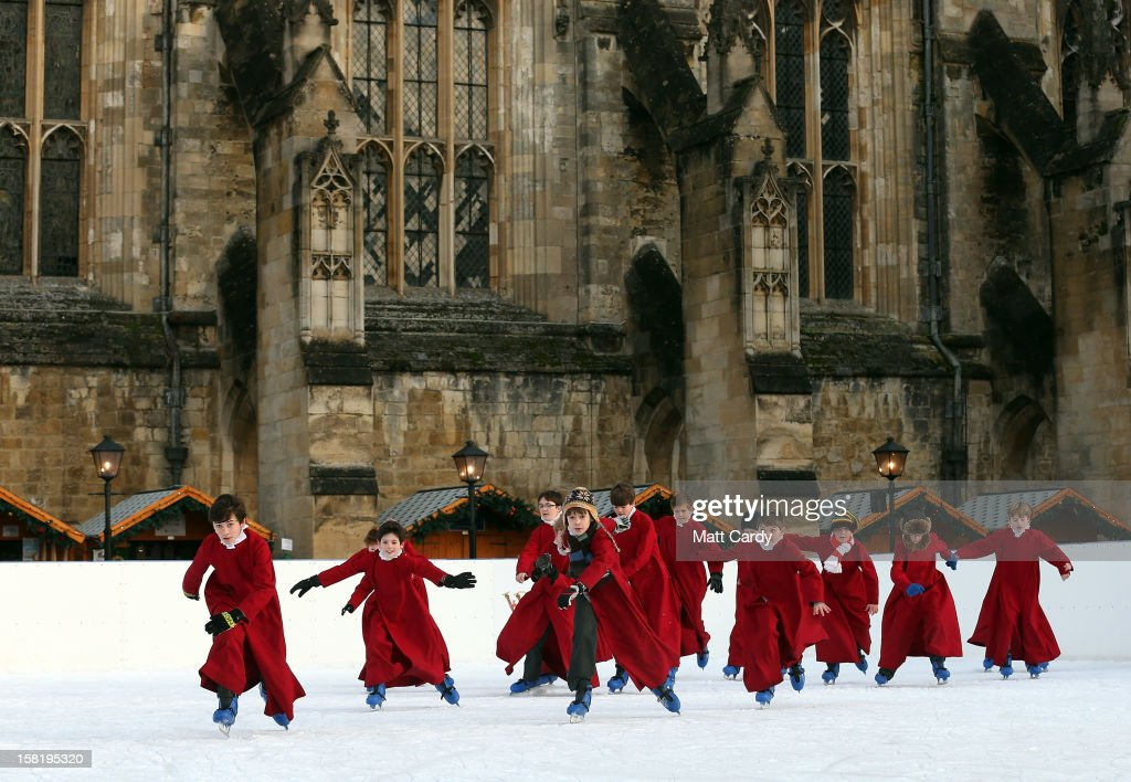 Choristers from Winchester Cathedral don ice-skates to enjoy the artificial rink set up beside the cathedral on December 11, 2012 in Winchester, England. Forecasters are warning that the UK could experience the coldest day of the year so far tomorrow, as temperatures could drop as low as -14C, bringing widespread ice, harsh frosts and freezing fog, bringing travel disruption and further warnings for heavy snow.