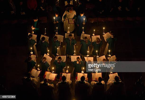 Choristers light their candles during the annual 'darkness to light' advent procession at Salisbury Cathedral on November 28 2014 in Salisbury...