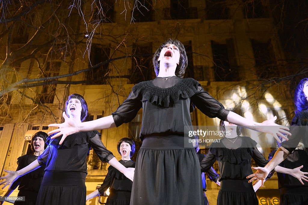 Choristers looking alike French singer Mireille Mathieu, whose group is named 'les Mireille', sing in front of the Theatre du Gymnase, on January 12, 2013 at the Vieux-Port harbour in Marseille, southern France, as part of the opening festivities marking Marseille as the 2013 European Capital of Culture. AFP PHOTO / BORIS HORVAT