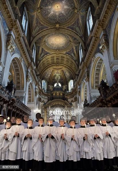 CORRECTION Choristers of St Paul's Cathedral rehearse inside the cathedral in central London on December 9 2016 The choristers will be performing...