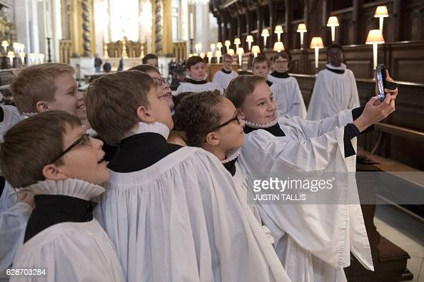 Choristers of St Paul's Cathedral take a 'selfie' photograph after rehearsing in the inside the cathedral in central London on December 9 2016 The...