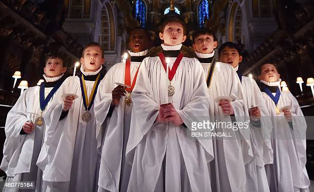 Choristers rehearse during a photocall in St Paul's Cathedral in central London on December 22 2014 It is estimated that on 23 24 and 25 December...