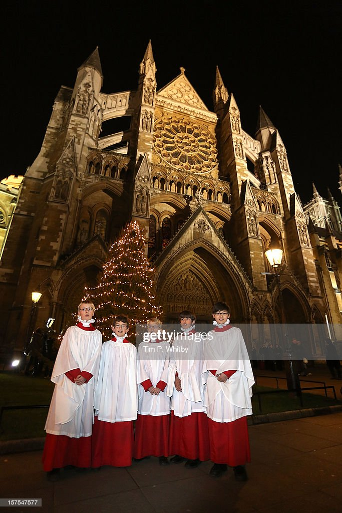 Choristers sing carols around the Christmas Tree which was blessed and switched on by The Very Reverend Dr John Hall at Westminster Abbey on December 4, 2012 in London, England.