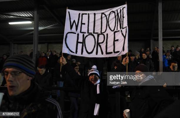 Chorley fan holds a Well Done Chorley Banner during The Emirates FA Cup First Round match between Chorley and Fleetwood Town at Victory Park on...