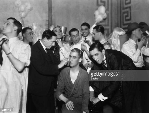 Chorus boys being made up for a production of 'Evergreen' at the Adelphi Theatre London