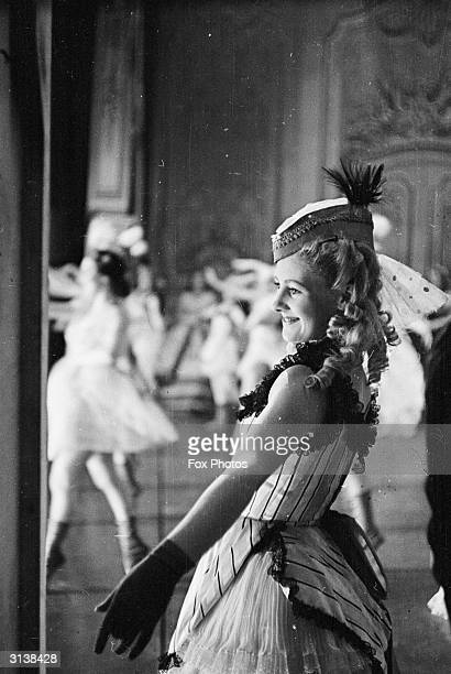 A chorus girl on stage at Drury Lane Theatre in London