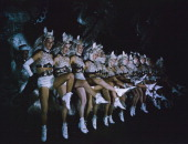 A chorus line of the Tiller Girls dance troupe performing in 'The Big Show Of 1949' at the London Palladium December 1949 They are wearing 'pony'...